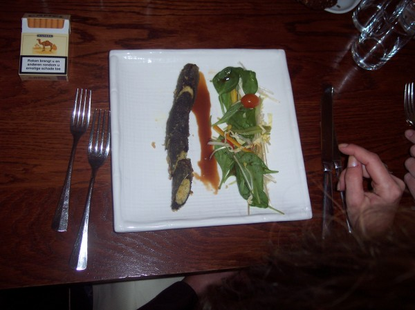 Nori rolled crocodile kebab fried in tempura on a watercress salad with an oyster sauce