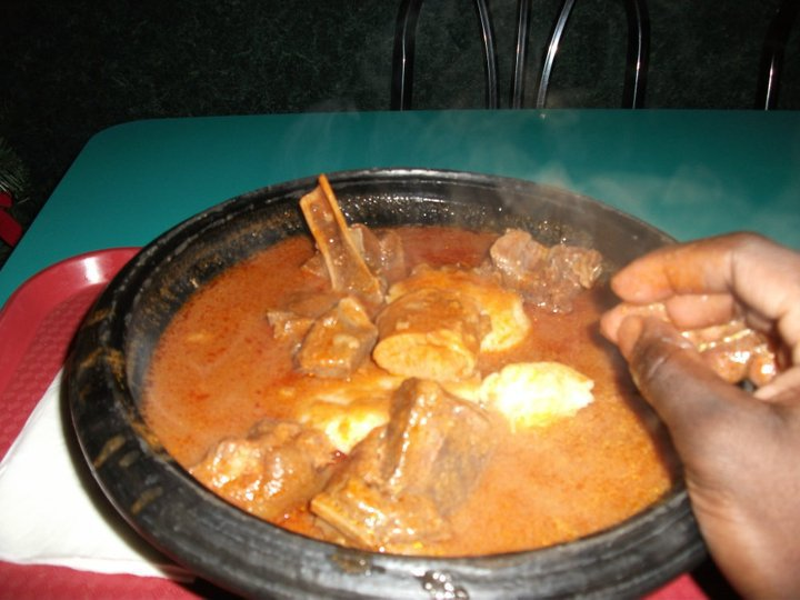 Omutuo and groundnut soup with goat meat.